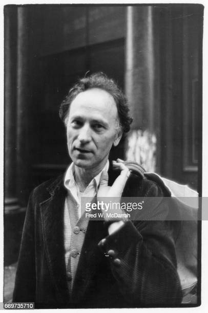 Portrait of Lithuanian American avantgarde film director Jonas Mekas a bag held over his shoulder as he poses outside the Village Voice offices New...