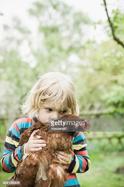 Portrait of little boy with chicken