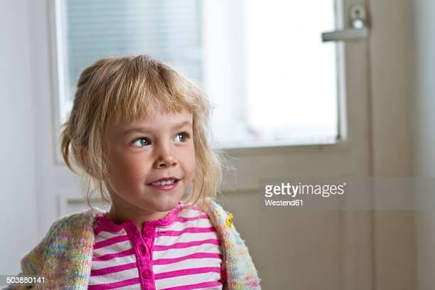 Portrait of little daydreaming girl