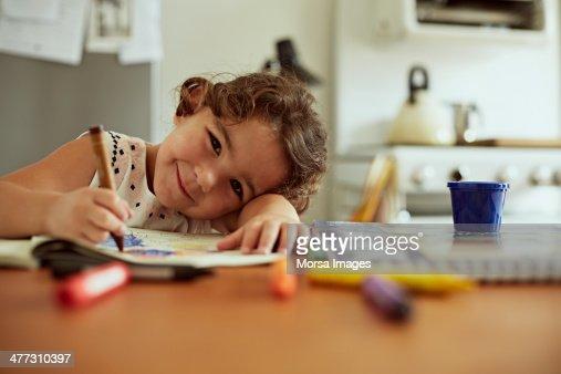 Portrait of little girl drawing