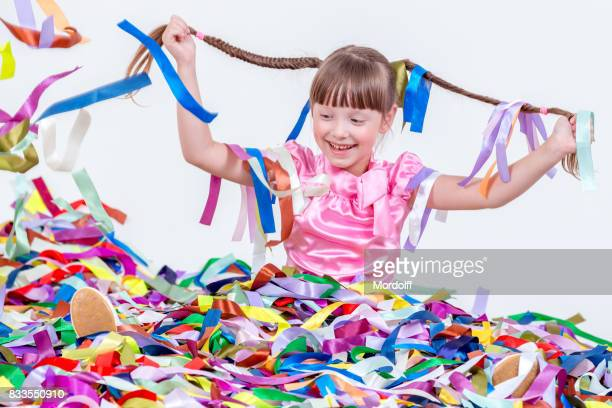 Portrait Of Little Girl. Fun At Children's Party With Ribbons