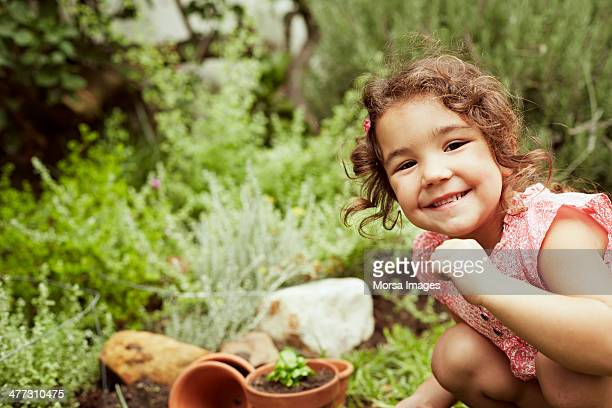 Portrait of little girl gardening