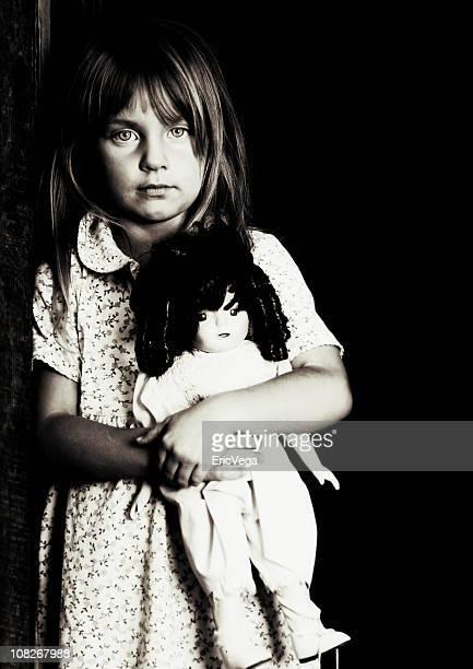 Portrait of Little Girl Holding Doll, Black and White