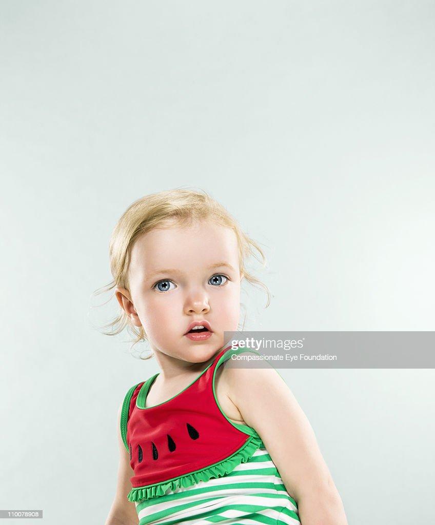 Portrait of little girl wearing a watermelon shirt : Stock Photo