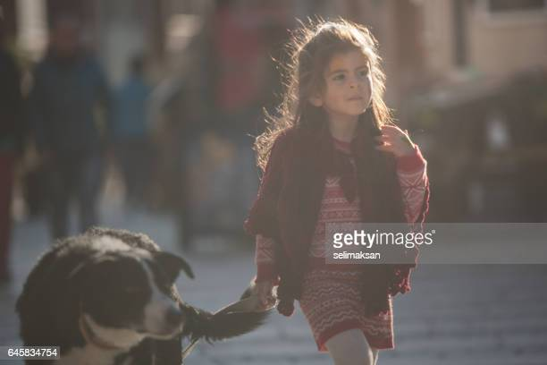 Portrait Of Little Girl With Her Border Collie Dog