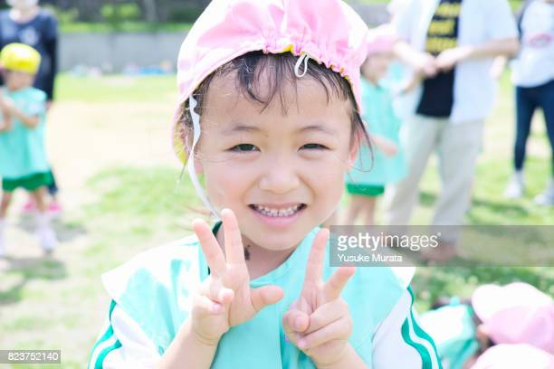 Portrait of little girl with piece sign