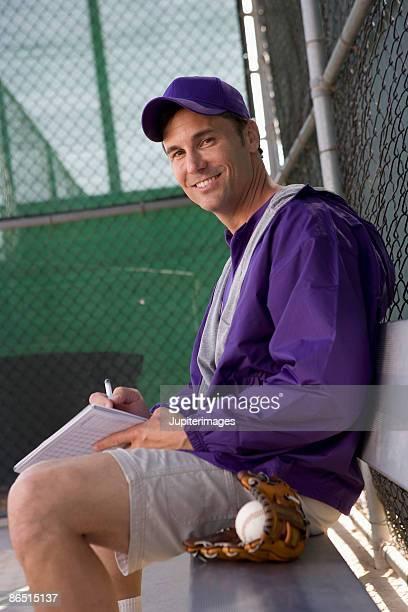 Portrait of little league coach in dugout