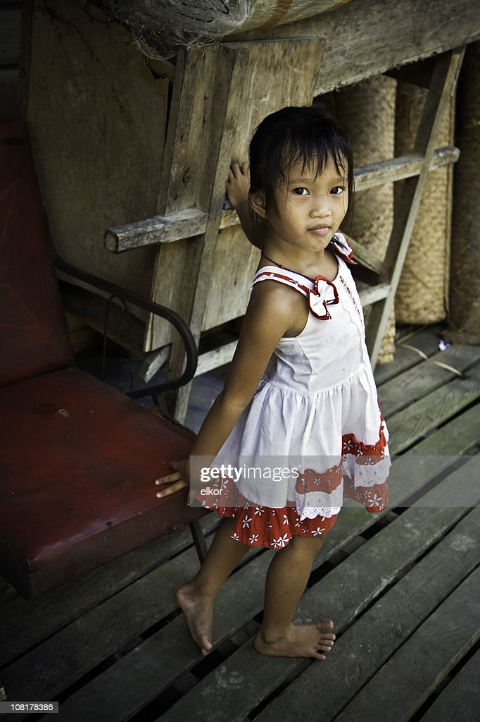 Portrait of Little Malaysian Girl Standing on Deck : Stock Photo