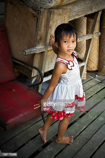 Portrait of Little Malaysian Girl Standing on Deck