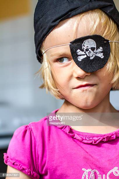 Portrait of little masquerading as a pirate