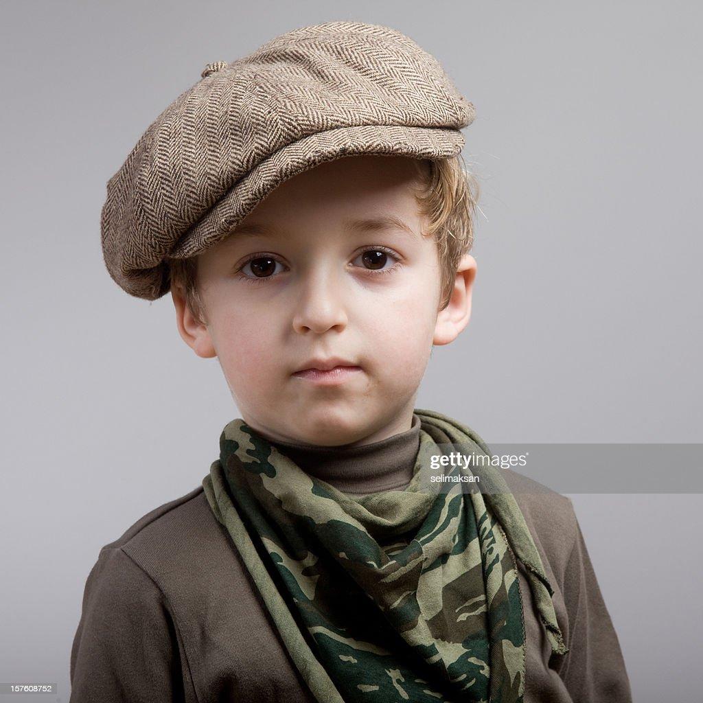 Portrait of little scout boy wearing flat newsboy cap