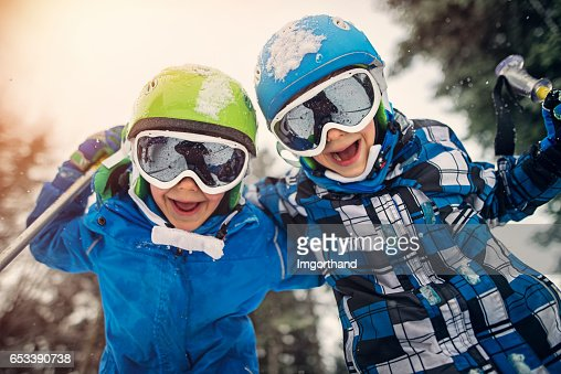 Portrait of little skiers  laughing at the camera : Stock-Foto