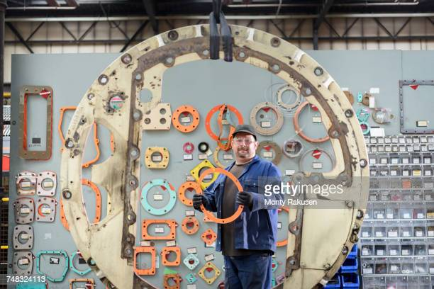 Portrait of locomotive engineer picking gaskets and seals in train works