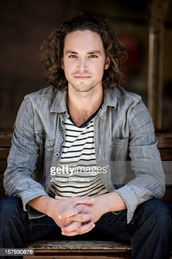 Portrait of long haired blue eyed man. : Stock Photo