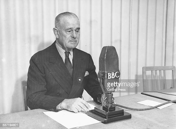 Portrait of Lord Wavell sitting at a BBC microphone 1947
