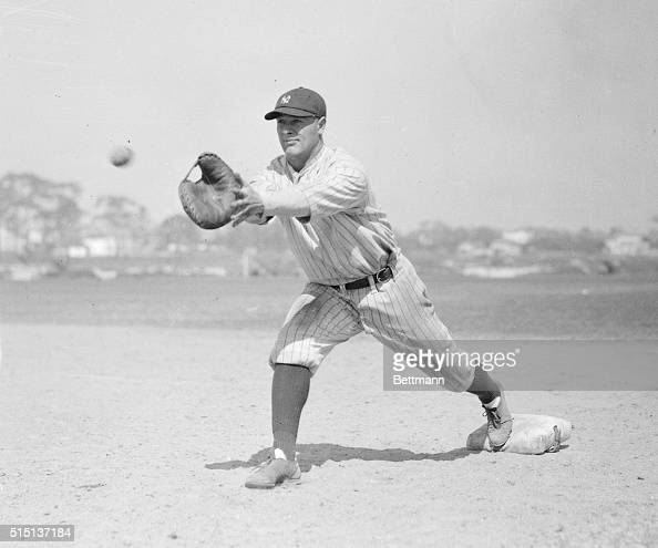 Portrait of Lou Gehrig catching ball on first base action pose
