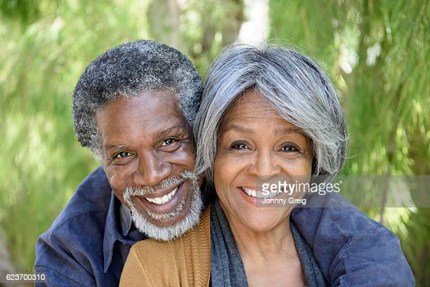 Portrait of loving senior African American couple