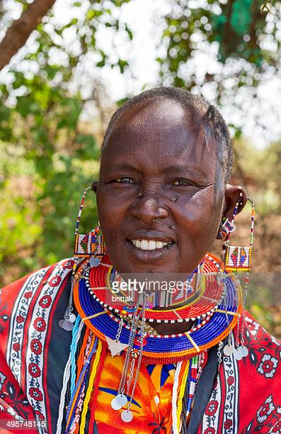 Portrait of Maasai woman in colorful dres and jewellery.