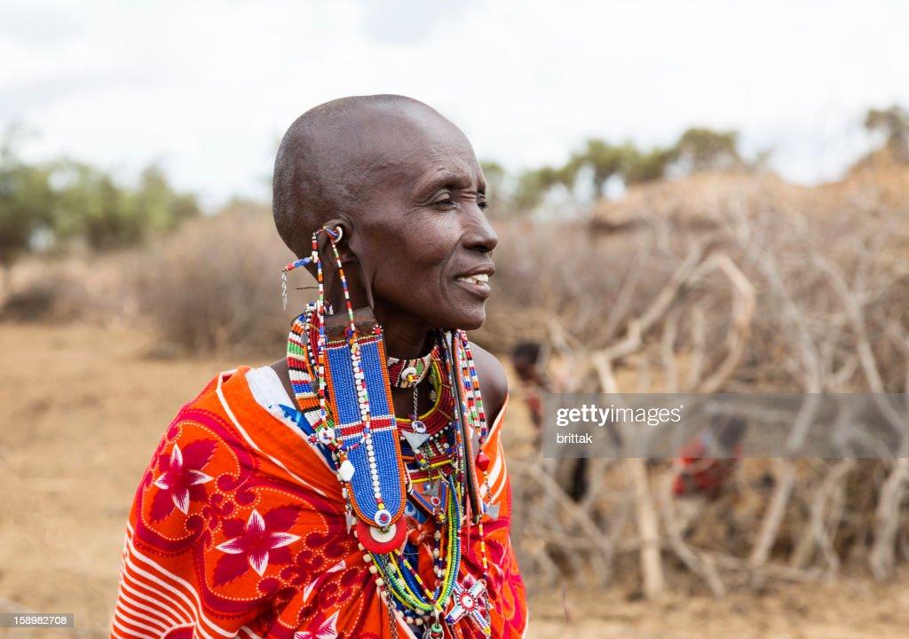 Portrait of Maasai woman outside village. : Stock Photo