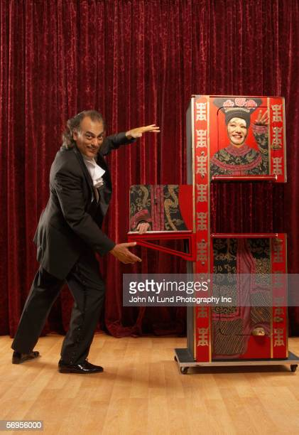 Portrait of magician on stage with prop