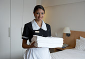 Portrait of maid in hotel room