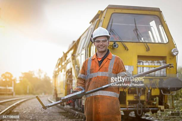 Portrait of maintenance apprentice on railway