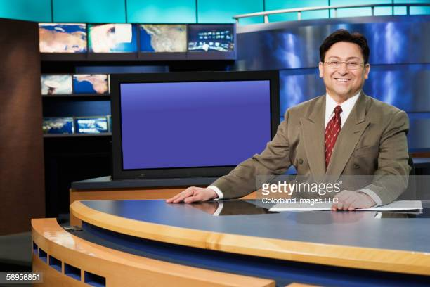 Portrait of male anchor in newsroom