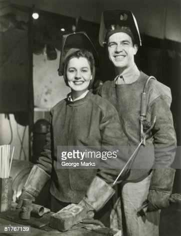 Portrait of male and female welder : Stock Photo