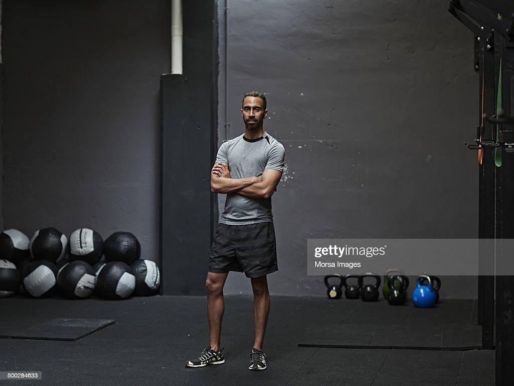 Portrait of male athlete in gym gym