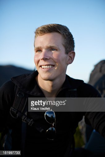 Portrait of male backpacker smiling : Stock Photo