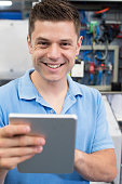 Portrait Of Male Engineer In Factory With Digital Tablet