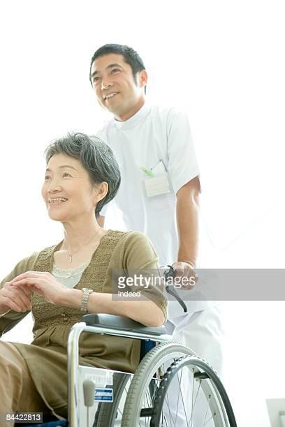 Portrait of male nurse and mature woman patient