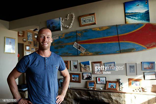 portrait of male surfer in his livingroom
