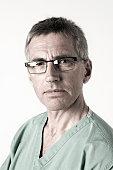 Portrait of male surgeon in scrubs.