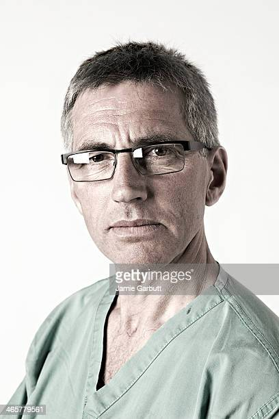 Portrait of male surgeon in scrubs.
