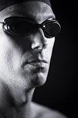 Portrait of male swimmer in swimming goggles