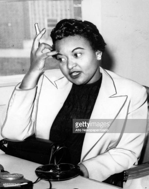 Portrait of Mamie Till Bradley mother of Emmett Till the teenager murdered in a racially motivated attack in Mississippi smoking a cigarette Sumner...