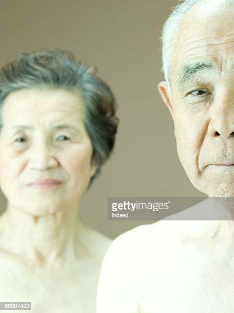 Portrait of man and woman, focus on man