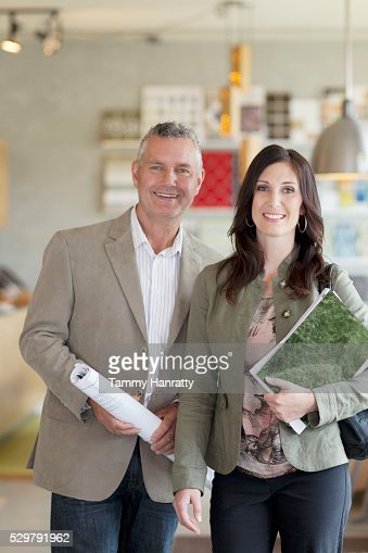 Portrait of man and woman in shop : Bildbanksbilder