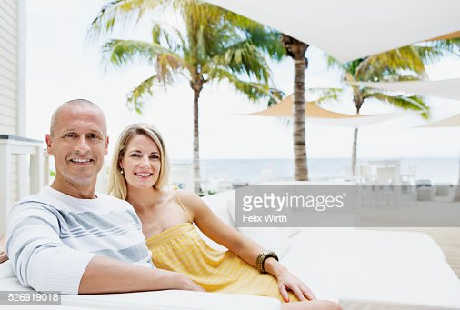 Portrait of man and woman relaxing at cafe nearby beach : Foto de stock