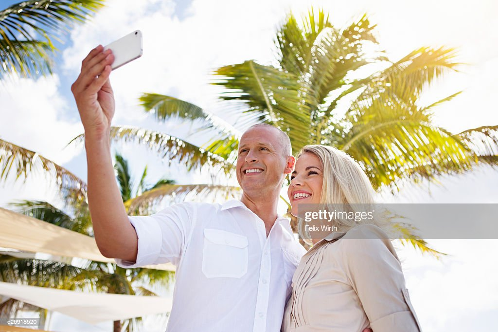 Portrait of man and woman using digital camera : Foto stock