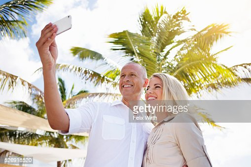 Portrait of man and woman using digital camera : Stock Photo