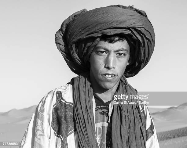 Portrait Of Man At Sahara Desert Against Clear Sky During Sunny Day