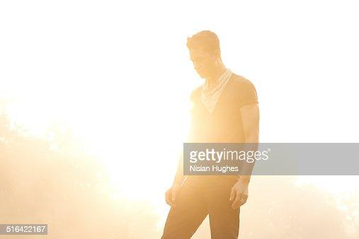 Portrait of man backlit by sun