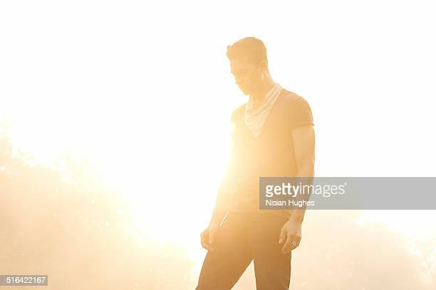 Portrait of man backlit by sun
