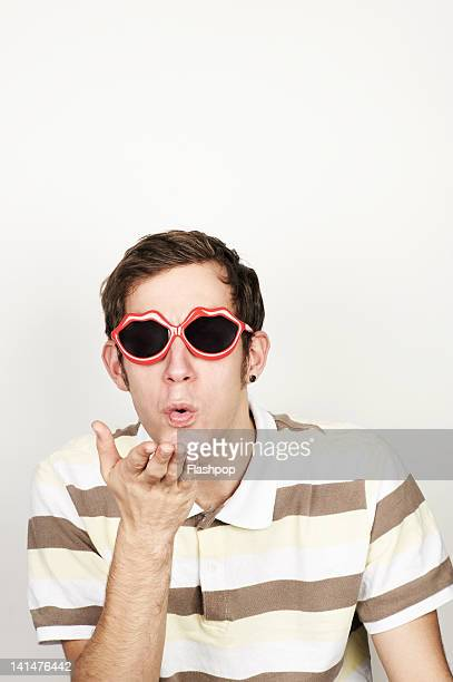 Portrait of man blowing a kiss