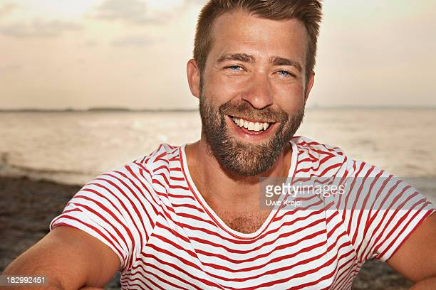 Portrait of man by the sea, smiling