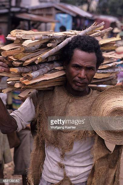 Portrait of man carrying firewood at the local farmers market in Mananjary in eastern Madagascar