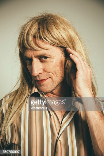 Portrait of man cross-dressed as blond woman