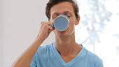 Portrait of Man Drinking Coffee, Taking a Sip